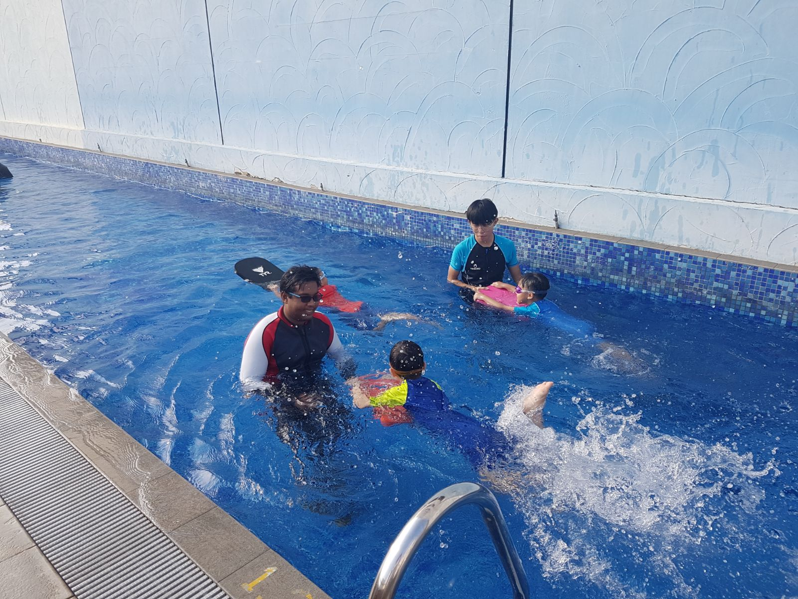 Swimming Coach with Kids Student